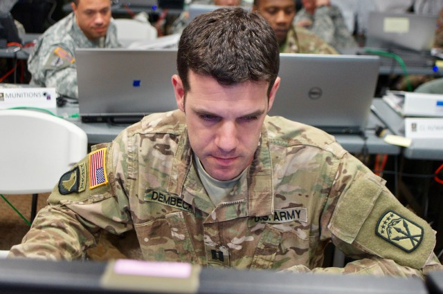 Capt. Michael Dembeck tracks operations along with other staff during exercise Key Resolve 2016 at the 593rd Sustainment Command (Expeditionary) Tactical Operations Center at Joint Base Lewis-McChord