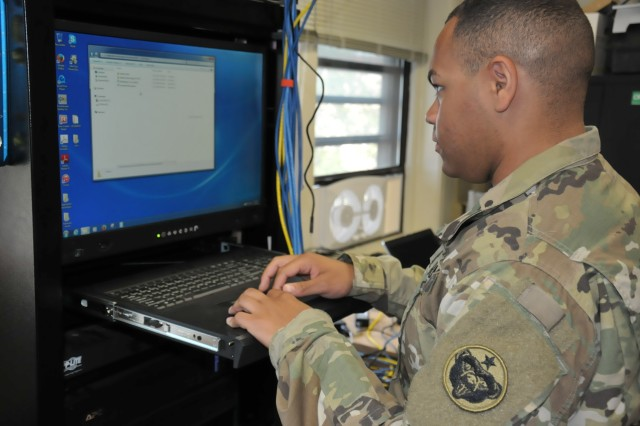 Spc. Isaiah Anderson, an Information Management Officer with U.S. Army Alaska updates the anti-virus software on a stand-alone, off-network computer in the signals section of USARAK headquarters. Cyber security is important on both military and civilian networks.