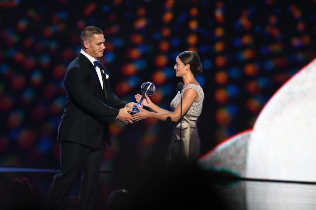 Paralympic swimmer Sgt. Elizabeth Marks of the U.S. Army World Class Athlete Program receives the Pat Tillman Award for Service trophy from John Cena at the ESPY Awards at Microsoft Theater in Los Angeles on July 13.
