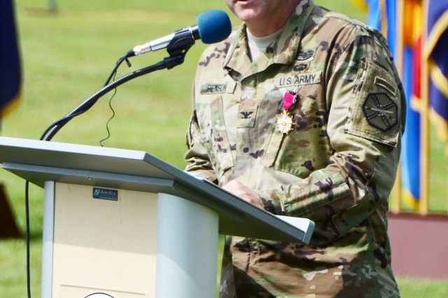 ANSBACH, Germany (July 18, 2016) -- Col. Christopher M. Benson gives a farewell address to U.S. Army Garrison Ansbach community members. U.S. Army Garrison Ansbach said farewell to commander Col. Christopher M. Benson and welcomed commander Col. Benjamin C. Jones during a ceremony on the Barton Barracks athletic field here today. (U.S. Army photo by Stephen Baack, USAG Ansbach Public Affairs)