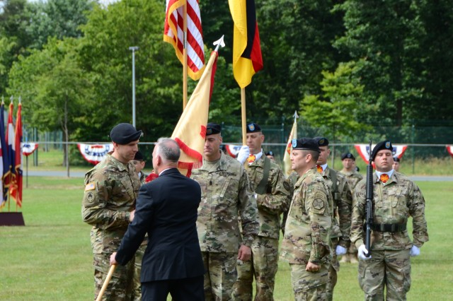 ANSBACH, Germany (July 18, 2016) -- Michael D. Formica, director of Installation Management Command - Europe, passes the U.S. Army Garrison Ansbach guidon to Col. Benjamin C. Jones, left, signifying Jones's assumption of command of the Ansbach garrison. U.S. Army Garrison Ansbach said farewell to commander Col. Christopher M. Benson and welcomed commander Col. Benjamin C. Jones during a ceremony on the Barton Barracks athletic field here today. (U.S. Army photo by Stephen Baack, USAG Ansbach Public Affairs)