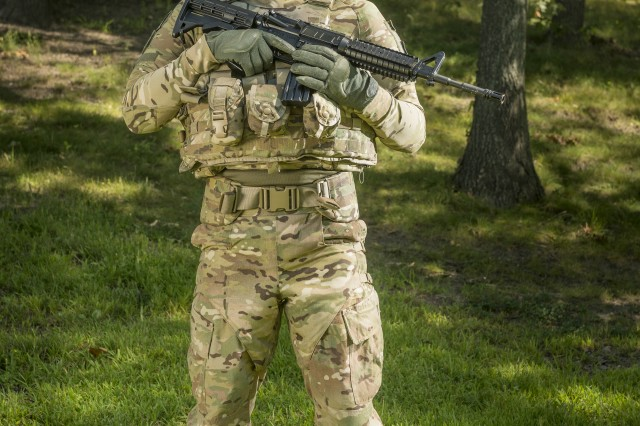 Natick's Robert DiLalla took a game-changing approach to develop the Ballistic Combat Shirt (pictured here under other protective gear). DiLalla focused on meeting the high-performance athletic needs of the Warfighter, resulting in a lighter weight, less bulky form of protection that doesn't hinder movement.