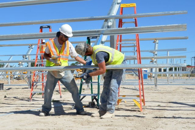 Construction crews from TetraTech and Hunt Electrical place the horizontal steel scaffolding July 30, 2015 that will support the panels for the new solar array at U.S. Army Dugway Proving Ground, Utah.  In July 2016, Dugway announced plans for a second array about 20 miles west of the housing area near the West Desert Test Center. Photo by Bonnie A. Robinson / Dugway Public Affairs.