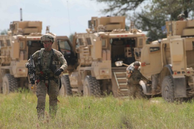 "A Trooper with 2nd Squadron ""Sabre,"" 3rd Cavalry Regiment walks toward a staging area to receive a briefing before daytime live-fire training July 14, 2016, inside the Fort Hood training area. (Photo by: Staff Sgt. Tomora Clark, 3rd Cavalry Regiment Public Affairs NCOIC)"