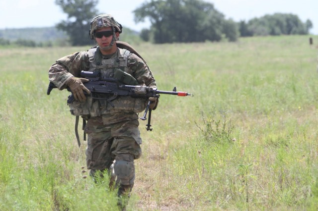 "A Trooper with 2nd Squadron ""Sabre,"" 3rd Cavalry Regiment walks toward a staging area before assaulting a trench system July 14, 2016 at Fort Hood's Crittenberger Multi-Purpose Range Complex. (Photo by: Staff Sgt. Tomora Clark, 3rd Cavalry Regiment Public Affairs NCOIC)"