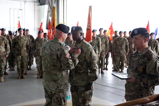 Maj. Gen. John B. Morrison Jr., commander of U.S. Army Network Enterprise Technology Command, presents a Legion of Merit award to Col. Jimmy L. Hall Jr., outgoing commander of 5th Signal Command (Theater), at the 5th Signal Command (Theater) change of command ceremony July 15, 2016 in Wiesbaden, Germany.