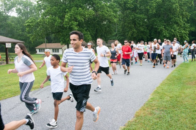Participants run in APHC (P)'s Organization Day 5k June 24.