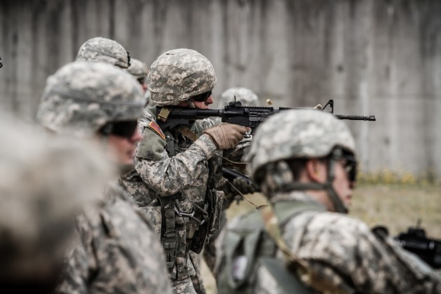 U.S. Army Soldiers, assigned to 16th Combat Aviation Brigade, 7th Infantry Division, fire M4 carbines during a reflexive-fire range at Joint Base Lewis-McChord, Wash., July 18, 2016. The range allowed Soldiers to use both the M4 carbine and M9 pistol to enhance weapon transition skills and marksmanship.