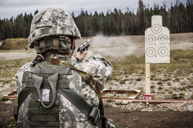 A U.S. Army Soldier, assigned to 16th Combat Aviation Brigade, 7th Infantry Division, fires an M9 pistol during a reflexive-fire range at Joint Base Lewis-McChord, Wash., July 18, 2016. The range allowed Soldiers to use both the M4 carbine and M9 pistol to enhance weapon transition skills and marksmanship.