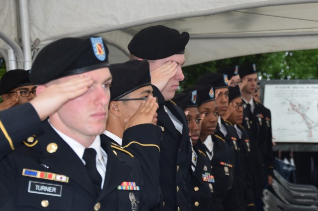 Soldiers assigned to 6th Battalion, 52nd Air Defense Artillery Regiment, stand at present arms during the Task Force Smith Memorial ceremony, July 5, Osan City, South Korea.