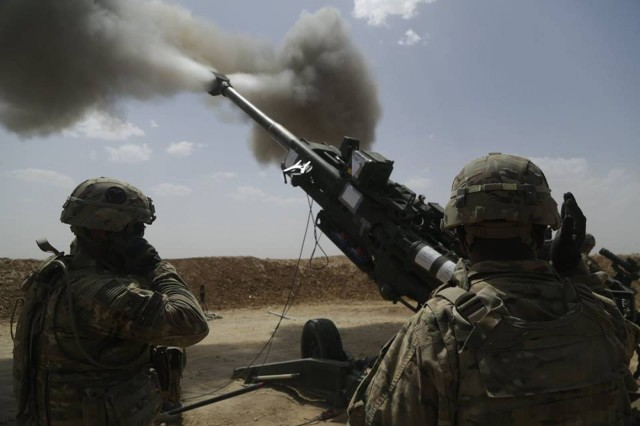 U.S. Soldiers with 1st Battalion, 320th Field Artillery Regiment, 2nd Brigade Combat Team, 101st Airborne Division (Air Assault), fire an M777 howitzer at Kara Soar Base, Iraq, May 23, 2016.