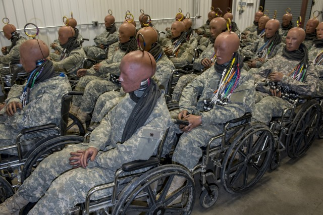 """Aberdeen Test Center at Aberdeen Proving Ground, Maryland, employs an expansive inventory of """"anthropomorphic test devices,"""" otherwise known as crash test dummies, to ensure armored vehicles will protect their occupants from roadside bombs. Most represent the average male Soldier, while others represent female Soldiers or larger males. According to lab technicians, the easiest way to move the ATDs from place to place is via wheelchair due to their cumbersome weight."""