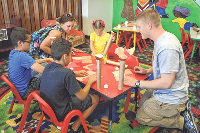 Summer readers create an Olympic torch during craft time Saturday at the Bruce C. Clarke Library. Photo by Caitlyn Marler, FMWR/Marketing