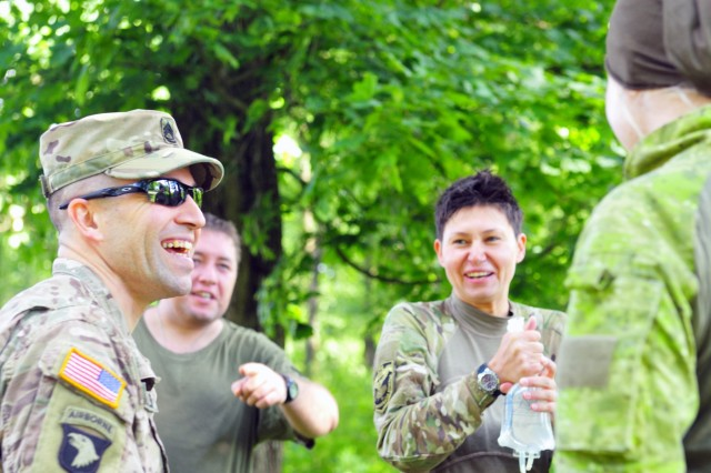 YAVORIV, Ukraine--Sgt. First Class Shon Crowley an instructor from the U.S. Army Security Assistance Training Management Organization shares a laugh with Ukrainian medics following their culminating training event at the International Peacekeeping and Security Center July 20. Soldiers from the USASATMO and instructors from the Army Medical Department in Fort Sam Houston, Texas were here to teach a three-month long combat medic instructor course. (Army photo by Capt. Scott Kuhn)