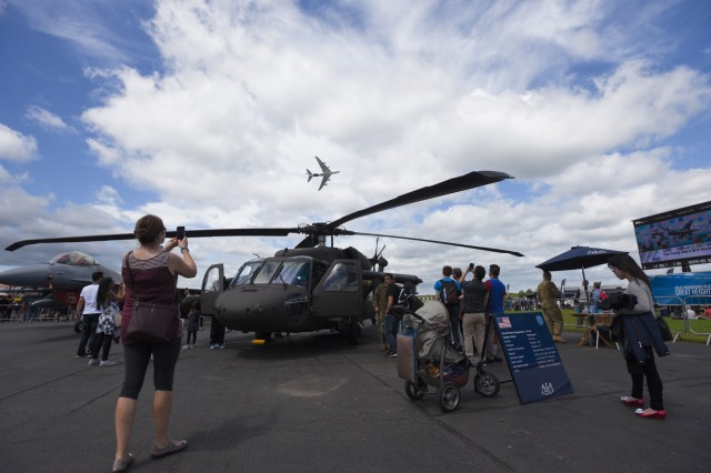 A UH-60M Black Hawk helicopter from Charlie Company, 3rd Bn., 501st Avn. Regt., 1AD CAB, sits on display, 15 July, 2016, during the Farnborough Air and Trade show which took place, 11-17 July, at TAG Farnborough Airport.  Static helicopter displays demonstrate USAREUR's ability to project rotary wing combat power around Europe in an expedient manner.