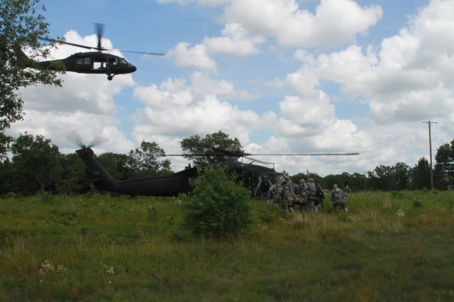 Army Reserve Soldiers from the 344th Military PoliceCompany, Clearwater, Florida load wounded Soldiers onto a UH-60 Black Hawk helicopter as a part of a  mass casualty scenario during Warrior Exercise 2016 at Fort McCoy, Wisconsin.