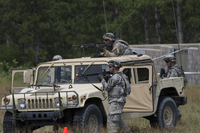 Army Reserve Soldiers from the 320th Military Police Company, St. Petersburg, Florida scan their sectors of fire from a Humvee as part of the quick reaction force in a mass casualty scenario during Warrior Exercise 2016 at Fort McCoy, Wisconsin.