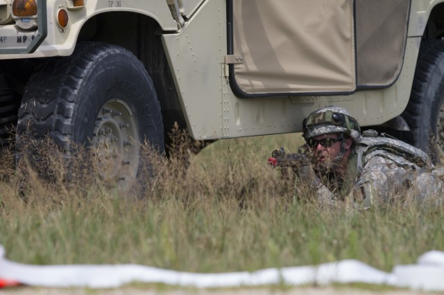 An Army Reserve Soldier from the 320th Military Police Company, St. Petersburg, Fla. provides security near a Humvee as part of the quick reaction force in a mass casualty scenario during Warrior Exercise 2016 at Fort McCoy, Wisconsin.