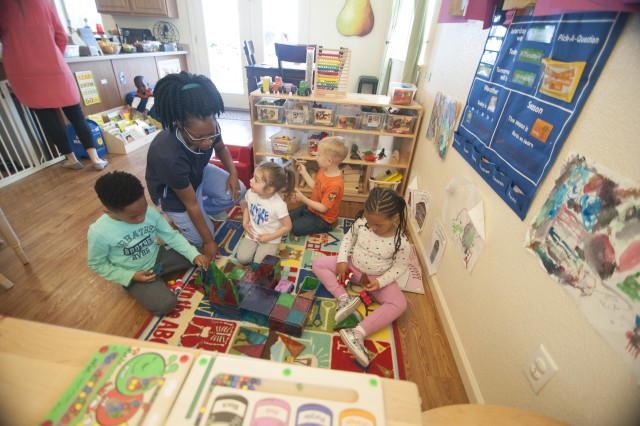 SEASIDE, California -- Tiffiny Edwards, second from left, cares for her daughter and three other children from her home in the Presidio of Monterey's Ord Military Community as a Family Child Care provider. Army Community Service's Family Child Care program matches the needs of military families seeking quality child care with family members seeking a portable career they can continue throughout their sponsor's time in service.