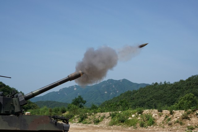 Soldiers from Battery B, 1st Battalion, 82nd Field Artillery Regiment, 1st Armored Brigade Combat Team, 1st Cavalry Division, fire a 155mm round from a M109A6 Paladin self-propelled howitzer at Nightmare Range, near Topyong-ri, South Korea, from July 20.