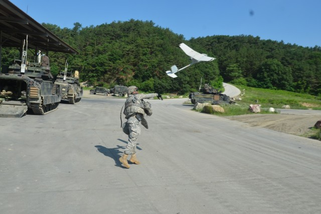 Spc. Steven Vawter, cavalry scout, Headquarters and Headquarters Troop, 1st Squadron, 7th Cavalry Regiment, 1st Armored Brigade Combat Team, 1st Cavalry Division, launches a Raven Small Unmanned Aerial Vehicle June 25 to conduct reconnaissance during gunnery tables for the regiment at the Rodriguez Live Fire Complex, near Pochang, South Korea. Cavalry Scouts incorporated Raven training into the gunnery exercises to add complexity and an additional training benefit. (U.S. Army photo by Staff Sgt. Matthew Bryant, 1st Squadron, 7th Cavalry Regiment, 1st ABCT)