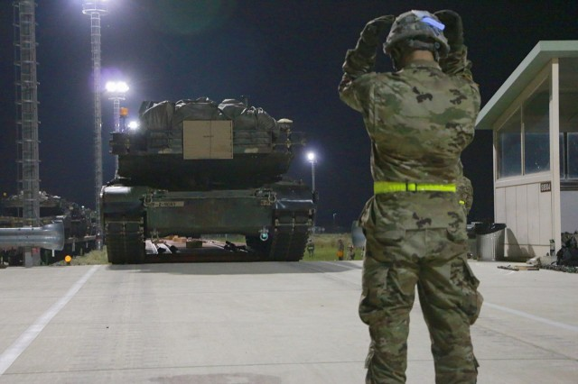 A Soldier from the 2nd Battalion, 5th Cavalry Regiment, 1st Armored Brigade Combat Team, 1st Cavalry Division, guides an M1A2 Abrams main battle tank off a railcar July 12 at U.S. Army Garrison Humphreys. The Fort Hood, Texas-based Soldiers of the 2nd Bn, 8th Cav. Reg., 1st ABCT, were among the first U.S. forces to make the move south of Seoul as part of a 2004 agreement between the U.S. and South Korea. (U.S. Army photo by Sgt. Christopher Dennis, 1st Armored Brigade Combat Team Public Affairs, 1st Cav. Div.)