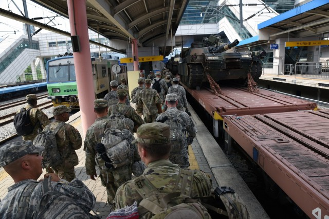 Soldiers move to board a passenger car at the end of train line-hauling tracked U.S. Army vehicles at the Dongducheon Station July 12. The Fort Hood, Texas-based Soldiers from the 2nd Battalion, 8th Cavalry Regiment, 1st Armored Brigade Combat Team, 1st Cavalry Division, moved with the vehicles from Camp Casey near the North Korean border to Camp Humphreys south of Seoul, South Korea, as part of a 2004 agreement to move all U.S. forces south of the Han River. (U.S. Army photo by Staff Sgt. Keith Anderson, 1st Armored Brigade Combat Team Public Affairs, 1st Cav. Div.)