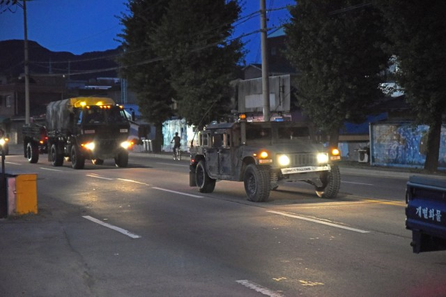 Fort Hood, Texas-based Soldiers from the 2nd Battalion, 8th Cavalry Regiment, 1st Armored Brigade Combat Team, 1st Cavalry Division, convoy through Dongducheon, South Korea, July 14, on their way to Camp Humphreys, as the beginning of the relocation of U.S. forces from near the North Korean border installations south of Seoul. (U.S. Army photo by Staff Sgt. Keith Anderson, 1st Armored Brigade Combat Team Public Affairs, 1st Cav. Div.)
