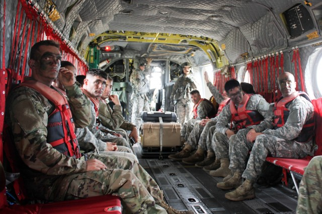 Thunderbolt Leaders from the 308th Brigade Support Battalion, 17th Field Artillery Brigade listen to a brief before jumping from a CH-47 Chinook into the waters of American Lake July 22. The helocast was part of an 11-hour Mungadai focused on leader development and resiliency.