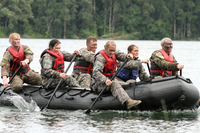 Lt. Col. Mike Labrecque (3rd from left), the commander of the 308th Brigade Support Battalion, 17th Field Artillery Brigade, and his team row to shore after completing the Helocast portion of a Mungadai, July 22,on Joint Base Lewis-McChord. The Mungadai tested Thunderbolt leaders during 17 events spread across 11 hours of competition.