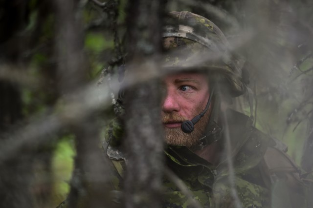 Canadian Army Master Cpl. Alex Fortier, assigned to Bravo Company, 1st Battalion, Princess Patricia's Canadian Light Infantry, mans his an concealed observation post in Donnelly Training Area near Ft. Greely, Alaska, during Arctic Anvil exercise, Sunday, July 24, 2016. Arctic Anvil is a joint, multinational exercise which includes forces from USARAK's 1st Stryker Brigade Combat Team, 25th Infantry Division and UATF, along with forces from the 196th Infantry Brigade's Joint Pacific Multinational Readiness Capability, the Iowa National Guard's 133rd Infantry Regiment and the 1st Battalion, Princess Patricia's Canadian Light Infantry.