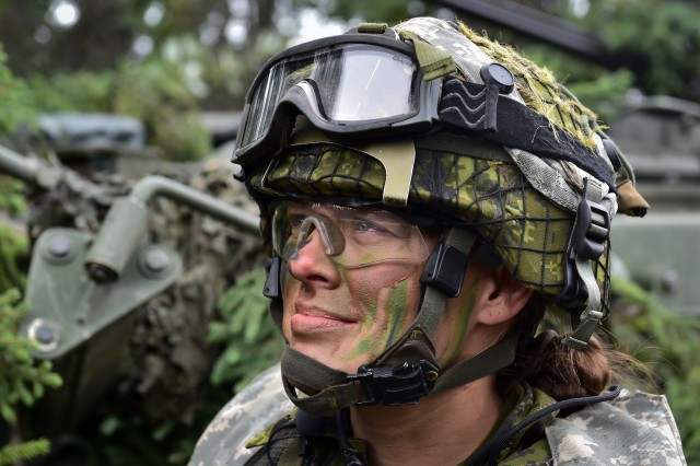 Canadian Army Maj. Chelsea Anne Braybrook, commander of Bravo Company, 1st Battalion, Princess Patricia's Canadian Light Infantry, smiles as she listens to a fellow soldier in Donnelly Training Area near Ft. Greely, Alaska, during the Arctic Anvil exercise, Sunday, July 24, 2016. Arctic Anvil is a joint, multinational exercise which includes forces from USARAK's 1st Stryker Brigade Combat Team, 25th Infantry Division and UATF, along with forces from the 196th Infantry Brigade's Joint Pacific Multinational Readiness Capability, the Iowa National Guard's 133rd Infantry Regiment and the 1st Battalion, Princess Patricia's Canadian Light Infantry.