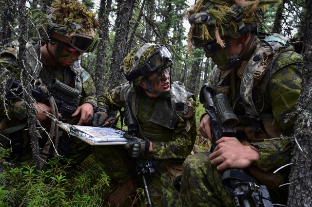 Canadian Army Maj. Chelsea Anne Braybrook, center, commander of Bravo Company, 1st Battalion, Princess Patricia's Canadian Light Infantry, passes information to Cpl. Brandon Balan, left, and Cpl. James Thoman in Donnelly Training Area near Ft. Greely, Alaska, during the Arctic Anvil exercise, Sunday, July 24, 2016. Arctic Anvil is a joint, multinational exercise which includes forces from USARAK's 1st Stryker Brigade Combat Team, 25th Infantry Division and UATF, along with forces from the 196th Infantry Brigade's Joint Pacific Multinational Readiness Capability, the Iowa National Guard's 133rd Infantry Regiment and the 1st Battalion, Princess Patricia's Canadian Light Infantry.