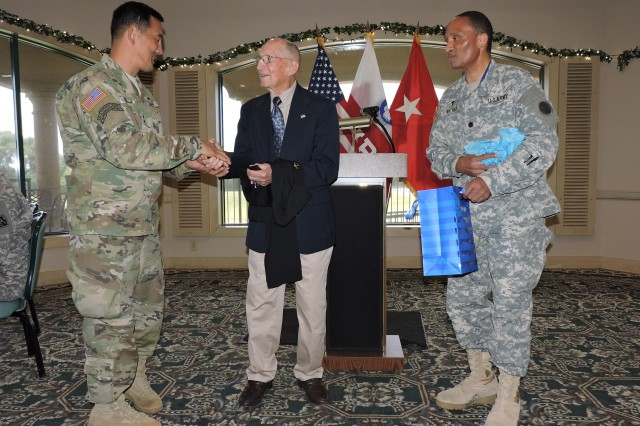 Guest speaker retired Army Maj. Gen. Floyd W. Baker accepts a token of appreciation from Maj. Gen. K.K. Chinn, U.S. Army South commanding general, at the conclusion of the command's quarterly prayer luncheon.