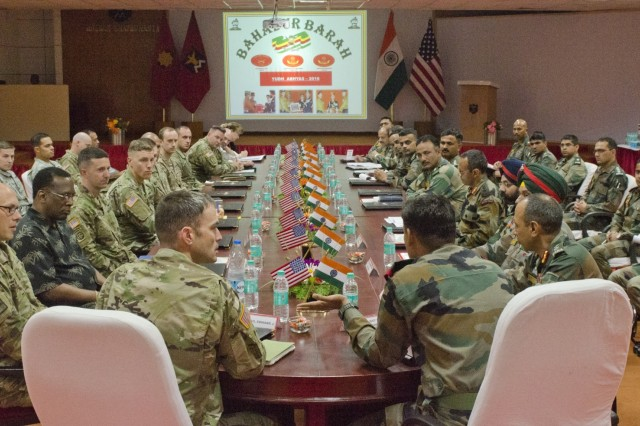 Members of 1-2 Stryker Brigade Combat Team (left) converse with their Indian counterparts July 18, 2016, at the Chaubatia Military Station in Ranikhet, India, about the details of the upcoming Yudh Abhyas exercise. Yudh Abhyas is a regularly-scheduled bilateral exercise hosted by the Indian and U.S. Armies which allows for an exchange of knowledge between the two militaries using a U.N. peacekeeping scenario. (U.S. Army photo by Staff Sgt. Samuel Northrup)
