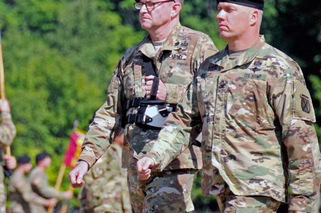 Col. David V. Gillum, left, and Col. Shawn C. Schuldt inspect the Soldiers ofthe 10th Mountain Division Sustainment Brigade during a change of command ceremony Wednesday on Sexton Field at Fort Drum. Gillum relinquished command to Schuldt to become the brigade's 14th commander since being reactivated on Fort Drum in 1985.
