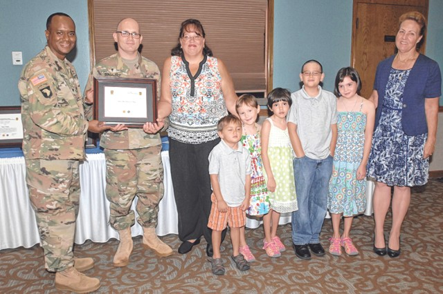 Col. Tracy Lanier, U.S. Army Garrison Fort Leonard Wood commander, far left, presents Chaplain (Capt.) Guido Gonzalez, his wife Jeanette and their children, the Volunteer of the Quarter Family award. Also pictured is Kathy Aydt, USAG Fort Leonard Wood deputy commander.