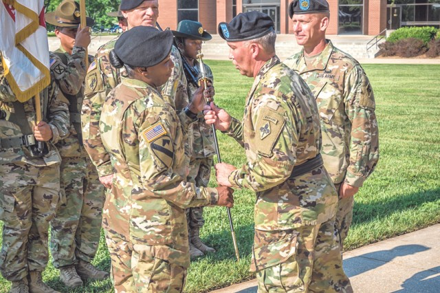 Command Sgt. Maj. Henney Hodgkins, left, receives the noncommissioned officer's sword from Brig. Gen. James Bonner, U.S. Army Chemical, Biological, Radiological and Nuclear School commandant, signifying her assuming responsibility as the 14th Regimental Command Sergeant Major of the CBRN School.