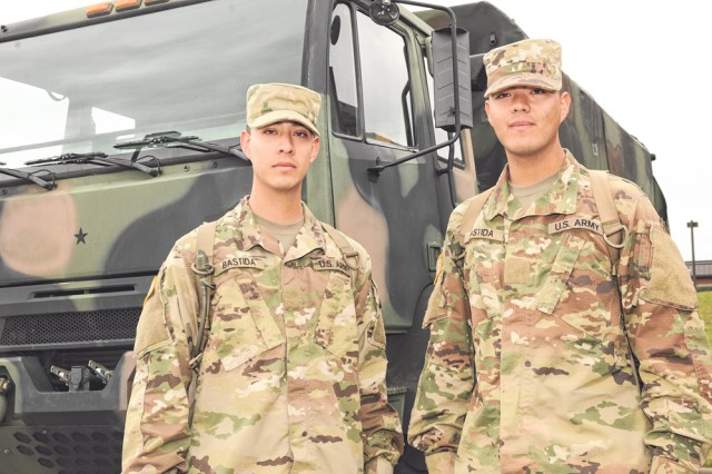 Pvt's Jorge, left, and Felipe Bastida joined the Army for educational benefits and the pride of serving a country that provided so much for their Family. The Bastida brothers recently graduated Advanced Individual Training as motor transport operators, and returned to Texas, where they will be serving in the Army Reserve with the 370th Transportation Company Detachment at Naval Air Station Kingsville in Texas.