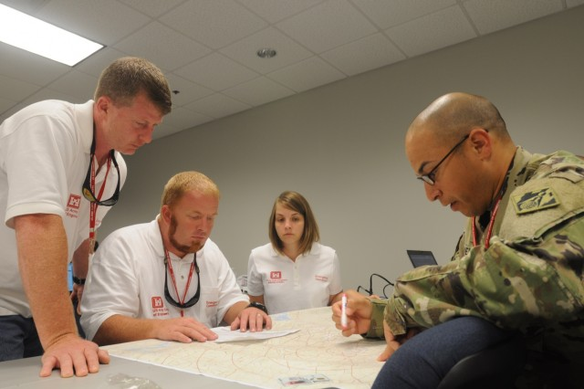 Members of a temporary emergency power planning and response team chart locations of life-saving facilities during a regional power mission exercise conducted July 20 at the FEMA Distribution Center in Atlanta, Georgia.