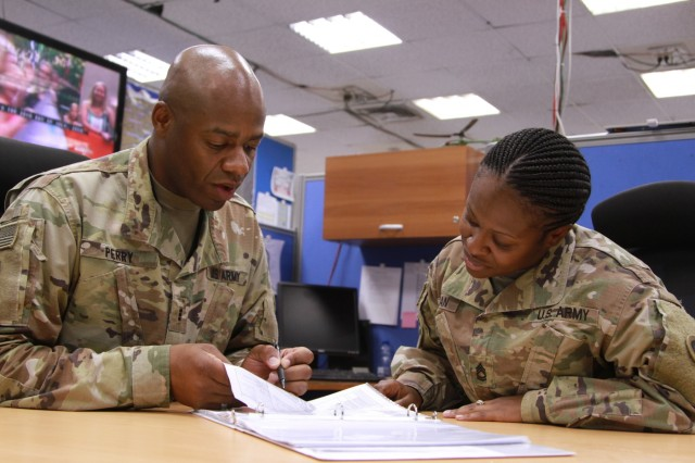 Soldiers review warrant officer packet