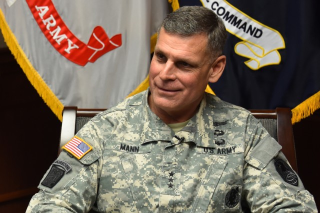 Lt. Gen. David L. Mann, commanding general, U.S. Army Space and Missile Defense Command/Army Forces Strategic Command, speaks with local media as he prepares to retire Aug. 2 after 35 years of service.
