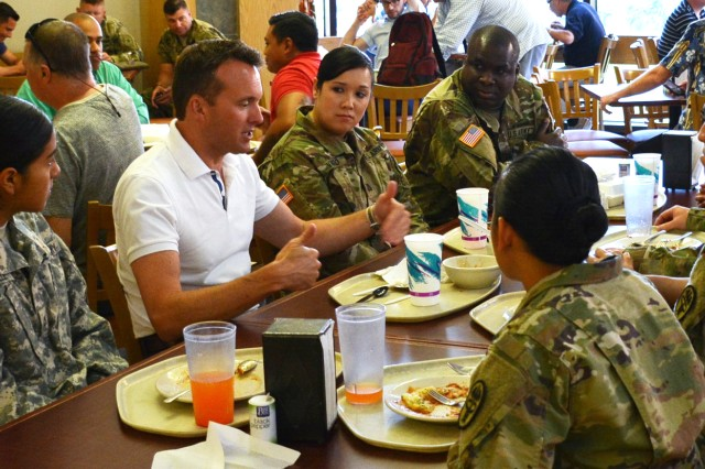 Secretary of the Army, Eric Fanning, meets with Soldiers from Troop Command to enjoy lunch at the Anuenue Café at Tripler Army Medical Center.  Fanning's visit to TAMC was part of his tour of the Pacific Command area of responsibility.