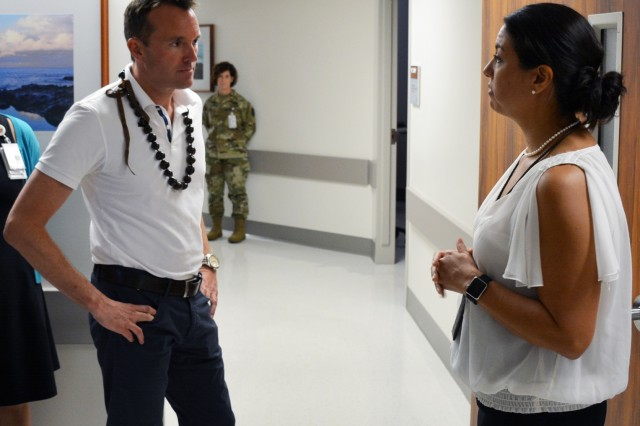 Secretary of the Army, Eric Fanning, meets with Dr. Jill Panos, Assistant director of the Tripler Army Medical Center Interdisciplinary Pain Management clinic. Fanning's visit to TAMC was part of his tour of the Pacific Command area of responsibility.