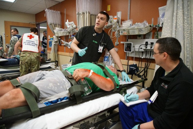 Doctors help the injured at the Madigan Army Medical Center during exercise Cascade Helix at Joint Base Lewis-McChord July 26, 2016