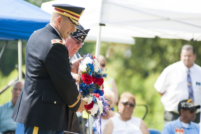 Col. Lance Koenig, chief of staff, U.S. Army Sustainment Command, and Ron Sears, Korean War veteran and president of the Korean War Veterans Association Chapter 168, place a wreath on the Korean War Stone during a ceremony commemorating the 63rd anniversary of the Korean War armistice at the Rock Island National Cemetery, Illinois, July 27.