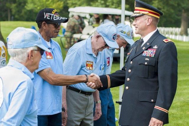Col. Lance Koenig, chief of staff, U.S. Army Sustainment Command, meets with Korean War veterans at a ceremony commemorating the 63rd anniversary of the Korean War armistice at the Rock Island National Cemetery, Illinois, July 27.