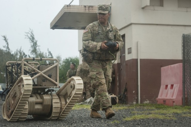 Army Pvt. Gilbert Galindo, 2nd Battalion, 27th Infantry Regiment, 3rd Brigade Combat Team, 25th Infantry Division, operates a 710 Warrior during the Pacific Manned-Unmanned Initiative on July 22 at Marine Corps Training Area Bellows, Hawaii.