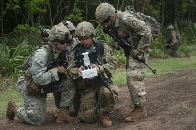 Army Pacific Soldiers, 25th Infantry Division, view video feed from a Phantom 4 (UAS) Quad Copter during the Pacific Manned-Unmanned Initiative on July 22 at Marine Corps Training Area Bellows, Hawaii.