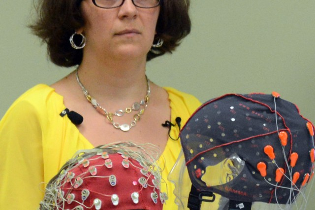 Dr. Jean Vettel, a neuroscientist at Army Research Laboratory, Aberdeen Proving Ground, Md., July 28, 2016, shows EEG sensors and caps used to monitor test subjects' brain wave patterns.